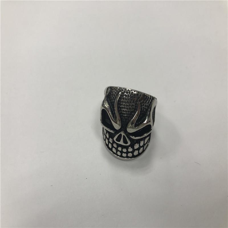 Grimacing Skull punk ring