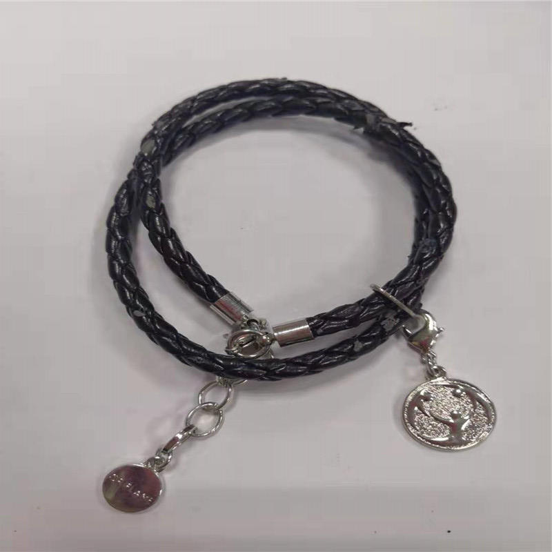 Coin pendant with woven bracelet