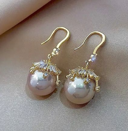 Glue the pearl earrings